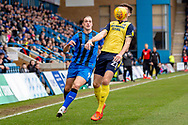 Scunthorpe United defender Cameron Burgess (21) and Gillingham FC forward Tom Eaves (9) during the EFL Sky Bet League 1 match between Gillingham and Scunthorpe United at the MEMS Priestfield Stadium, Gillingham, England on 16 February 2019.