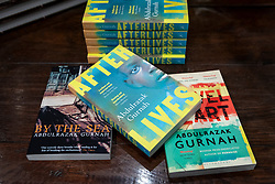 © Licensed to London News Pictures. 07/10/2021. LONDON, UK.  Novels by UK based Tanzanian writer Abdulrazak Gurnah are displayed in Waterstones bookshop in Piccadilly.  The novelist has just won the Nobel Prize for Literature for his work that explores the effect of migration on uprooted people and their new homes.  The award includes a gold medal and 10 million Swedish kroner (US$1.14m).  Photo credit: Stephen Chung/LNP