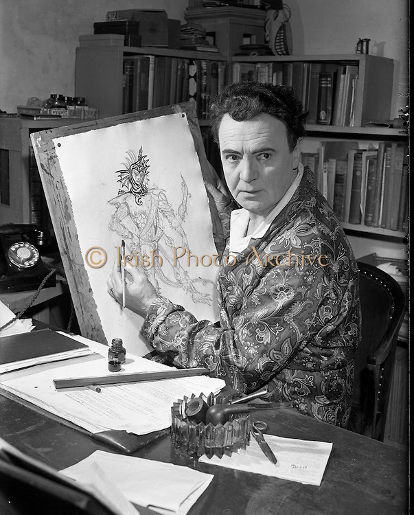 Micheál Mac Liammóir 1956 -  17:05.1956..Pictured sketching costume designs, for a forthcoming production, at his home in Harcourt Terrace is Micheál Mac Liammóir. .Mr Mac Liammóir and his partner Mr Hilton Edwards are the co-founders of Dublin's Gate Theatre.