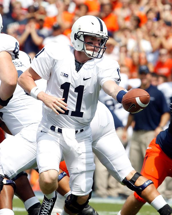 Penn State quarterback Matthew McGloin (11) hands off the ball during an NCAA college football game against Virginia in Charlottesville, Va. Virginia defeated Penn State 17-16.