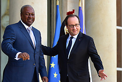 French President Francois Hollande and the Libyan prime minister Fayez El-Sarraj receives receives John Dramani Mahama, President of The Republic of Ghana for a meeting at the Elysee Palace in Paris, France on September 27, 2016. Photo by Christian Liewig/ABACAPRESS.COM