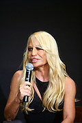 Italian designer Donatella Versace speaks to the media during a news conference in Beijing, China, on Monday, October 16, 2006. Versace, creative director of the Versace Group, spoke about plans to expand outlets in Beijing as demand for luxury apparels and goods increase in the area.