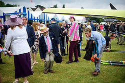 © Licensed to London News Pictures. 28/06/2017. London, UK. Spectators duck underneath a boat as it is carried from the water on day one of the Henley Royal Regatta, set on the River Thames by the town of Henley-on-Thames in England.  Established in 1839, the five day international rowing event, raced over a course of 2,112 meters (1 mile 550 yards), is considered an important part of the English social season. Photo credit: Ben Cawthra/LNP