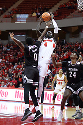 """07 January 2018:  Daouda """"David"""" Ndiaye puts up a shot while double teamed by Abdul Fofana and Alize Johnson during a College mens basketball game between the Missouri State Bears and Illinois State Redbirds in Redbird Arena, Normal IL"""