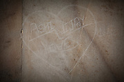 A heart-shaped graffiti is seen on the Taj Mahal's Markana marble, inside the main tomb area, in Agra.