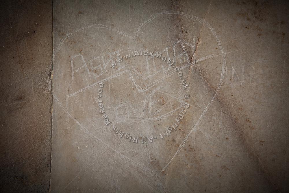 A heart-shaped graffiti is seen on the Taj Mahal's Markana marble, inside the main tomb area, in Agra.