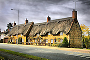 Thatch cottages overlook the Village green in Barton Seagrave, Northamptonshire