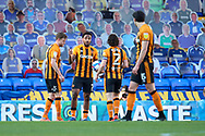 Discussion about who is going to take a penalty for Hull during the EFL Sky Bet League 1 match between AFC Wimbledon and Hull City at Plough Lane, London, United Kingdom on 27 February 2021.