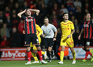 AFC Bournemouth midfielder Dan Gosling holds his head in his hands after going close during the Capital One Cup match between Bournemouth and Liverpool at the Goldsands Stadium, Bournemouth, England on 17 December 2014.