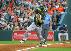 April 29, 2018 - Houston, TX, U.S. - HOUSTON, TX - APRIL 29:  Oakland Athletics right fielder Stephen Piscotty (25) rounds the bases and heads to home plate in the top of the seventh inning during the baseball game between the Oakland Athletics and Houston Astros on April 29, 2018 at Minute Maid Park in Houston, Texas.  (Photo by Leslie Plaza Johnson/Icon Sportswire) (Credit Image: © Leslie Plaza Johnson/Icon SMI via ZUMA Press)