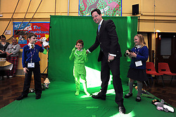 © Licensed to London News Pictures. 27/01/2012, Solihull, UK. NICK CLEGG is shown green screen technology being used by the children to create a film. NICK CLEGG  the British Deputy Prime Minister and Liberal Democrat leader is joined by Member of Parliament for Solihull LORLEY BURTat Peterbrook Primary School, Solihull, to see how the local primary school is using its Pupil Premium money. 27th January 2012.   Photo credit : Stephen Simpson/LNP