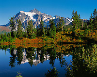 Mt. Shuksan, WA, USA.Mt. Shuksan in North Cascades National Park..Reflection in Picture Lake from Mt. Baker Wilderness..Fall Colors of Blueberries, Willow and Mt. Ash..Brett Baunton