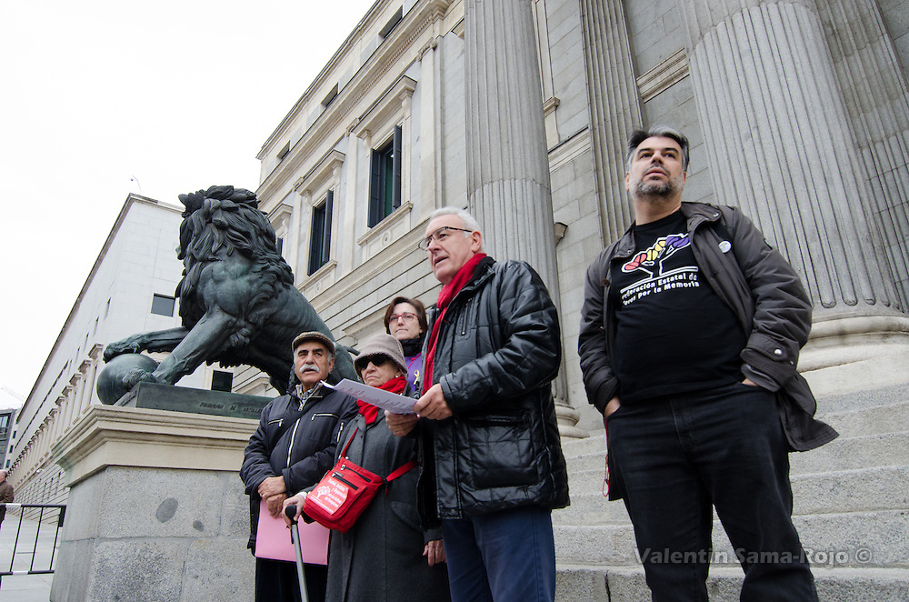 Cayo Lara (2nd R) at the Spanish Parliament gates making a statement about the request for a political commitment for the Historical Memory with victims of francoism delivered by Julian Rebollo (L).