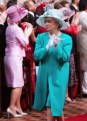 STRICT EMBARGO TO 00:01 FRIDAY 15 APRIL 2011 © licensed to London News Pictures. LONDON, UK  12/04/11. HRH Queen Elizabeth II dances in the aisle. The filming of a new T-Mobile advert in which Kate Middleton and Prince William lookalikes pretend to get married at a mock royal wedding. The filming took place at St Bartholomew the Great Church in London. All the main royal family members and the Arch Bishop of Canterbury were played by actors. The actors danced down the aisle with moves choreographed by Louie Spence. Please see special instructions. Photo credit should read Cliff Hide/LNP.