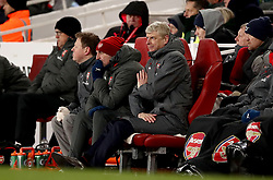 Arsenal manager Arsene Wenger and assistant manager Steve Bould (left) in the dugout