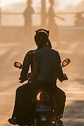 Motorcycle as the sunsets, Monywa, Myanmar