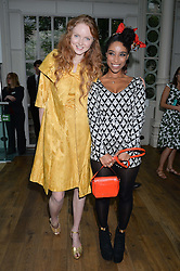Left to right, LILY COLE and LIANNE LA HAVAS at The Women for Women International & De Beers Summer Evening held at The Royal Opera House, Covent Garden, London on 23rd June 2014.