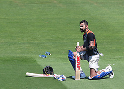 India's Virat Kohli repairs his bat handle grip during a nets session at The SSE SWALEC, Cardiff.