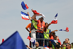 Airport workers wave flags upon Team France arrival at the Roissy-Charles de Gaulle airport on the outskirts of Paris, France, on July 16, 2018 after winning the Russia 2018 World Cup final football match. Photo by ABACAPRESS.COM