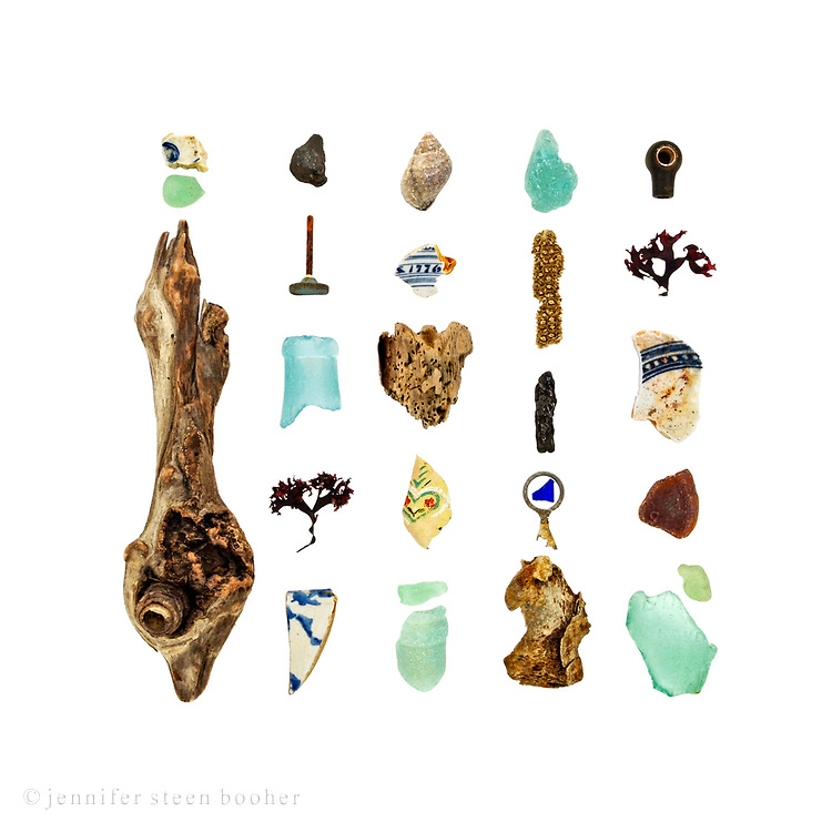 Beachcombing in Maine in March is something of an endurance test, so 30ºF felt like a spring thaw. I headed straight for my favorite (most interestingly garbage-strewn) beach. <br /> <br /> Pottery shards from the late 1800s to 1960s, sea glass, driftwood, coal, metal knob, Irish Moss seaweed (Chondrus crispus), Dog Whelk (Nucella lapillus), wallpaper, corncob, soda can pull-tab, bone, and plastic knob. The bottle necks are typical of early 20th-century soda bottles.<br /> <br /> This image is also available through Anthropologie: www.anthropologie.com