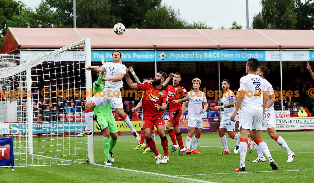 Johnny Mullins of Luton heads the ball clear under pressure from Joe McNerney of Crawley during the Sky Bet League 2 match between Crawley Town and Luton Town at the Checkatrade Stadium in Crawley. September 17, 2016.<br /> Simon  Dack / Telephoto Images<br /> +44 7967 642437