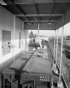 "Ackroyd 04969-1/4""Amalgamated Sugar Co. Loading sugar into sugar car at factory. February 9, 1954."" (factory at 2600 NE Columbia.)"