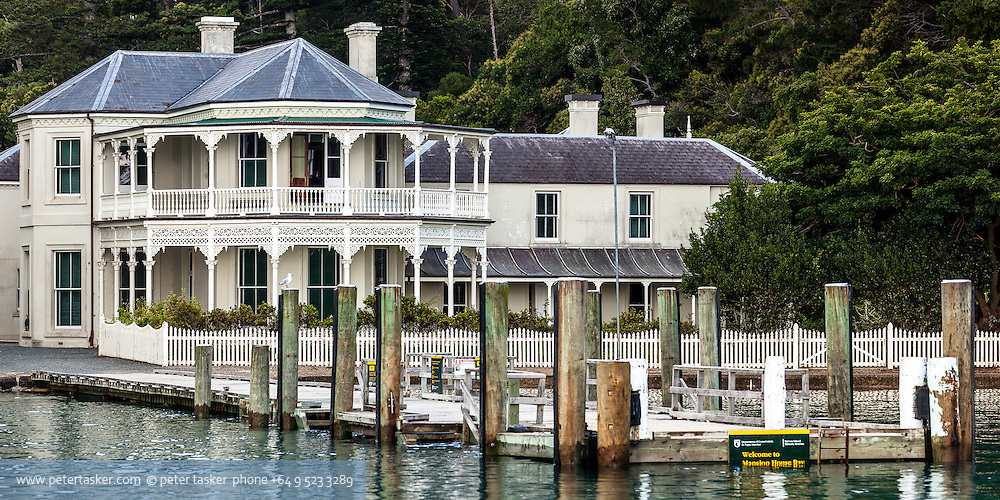 Mansion House, Kawau Island, Hauraki Gulf, New Zealand. Developed  1862 - 1867, by Sir George Grey, Governor of New Zealand.  Became part of Hauraki Gulf Maritime Park in 1967. Comprehensive restoration began in 1977. Photographed during an unusually high tide.