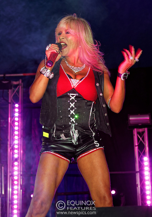 London, United Kingdom - 29 June 2013<br /> Gay Pride 2013 celebration. Singer and former Page 3 topless model Sam Fox performing at Summer Rites / Pride Party In The Park, Shoreditch Park, Hoxton, London, England, UK.<br /> Contact: Equinox News Pictures Ltd. +448700780000 - Copyright: ©2013 Equinox Licensing Ltd. - www.newspics.com<br /> Date Taken: 20130629 - Time Taken: 190541
