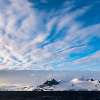 View of the mountainous landscape as seen from the Orleans Strait near the Palmer Archipelago, Antarctica.