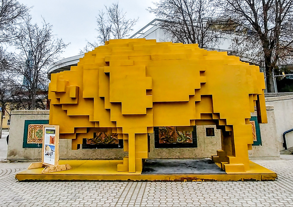 An artistic yellow bison warming hut on display at The Forks in downtown Winnipeg, Manitoba