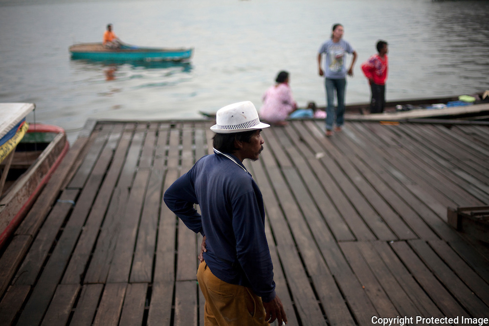 A local man stands on the dock in Semporna in the State of Sabah on the Island of Borneo, Malaysia.