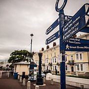 Signs providing directions on The Parade to several sights and landmarks in the Welsh beach resort town of Llandudno.