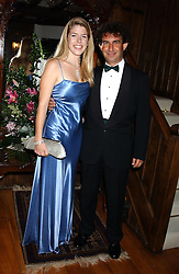 The HON.VICTORIA TRYON and MR DOMINIC SELIGMAN at a charity dinner hosted by Jennie Hallam-Peel to promote the London Debutante Season held at her home Somerhill, Rowdean Crescent, Brighton on 12th September 2004.