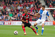 Lewis Grabban (L) of AFC Bournemouth Jason Lowe (R) of Blackburn Rovers during the Skybet Championship match AFC Bournemouth v Blackburn Rovers at The Goldsands Stadium in Bournemouth, England on Saturday 28th September 2013. Picture by Sophie Elbourn/Andrew Orchard Sports Photography.
