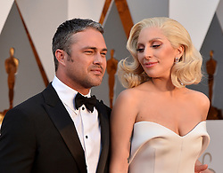 File photo - (L-R) Taylor Kinney and Lady Gaga attend the 88th Academy Awards in Los Angeles, CA, USA, February 28, 2016. Lady Gaga and Taylor Kinney have split after five years together. The couple, who got engaged on Valentine's Day 2015, ended their relationship earlier this month. Photo by Lionel Hahn/ABACAPRESS.COM  | 536650_123 Los Angeles Etats-Unis United States