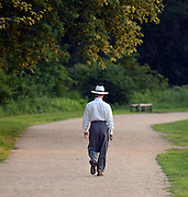 A man strolls through the Minute Man National Historical Park in Concord in July 2013.