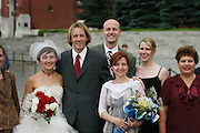 Wedding party by Lenin's tomb in Red Square, Moscow, Russia.