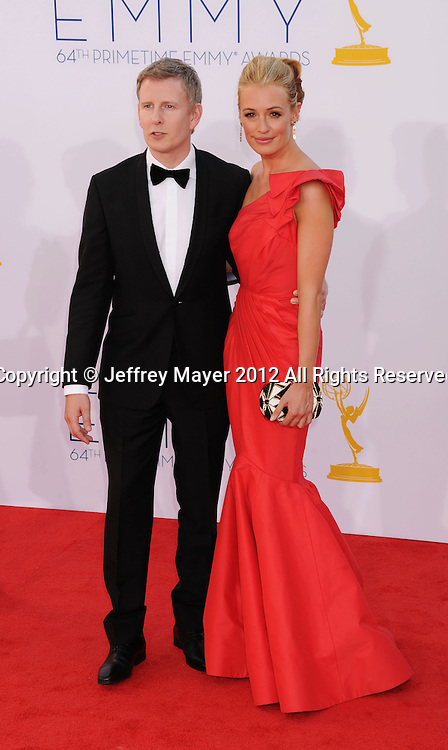 LOS ANGELES, CA - SEPTEMBER 23: Cat Deeley and guest arrive at the 64th Primetime Emmy Awards at Nokia Theatre L.A. Live on September 23, 2012 in Los Angeles, California.