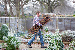 Cutting down and clearing up debris from the vegetable plot