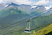 The Alyeska Aerial Tram climbs up the mountains in Girdwood, Alaska. The cable tram climbs 2,300 feet to the top of Mt. Alyeska in the Church Mountains.