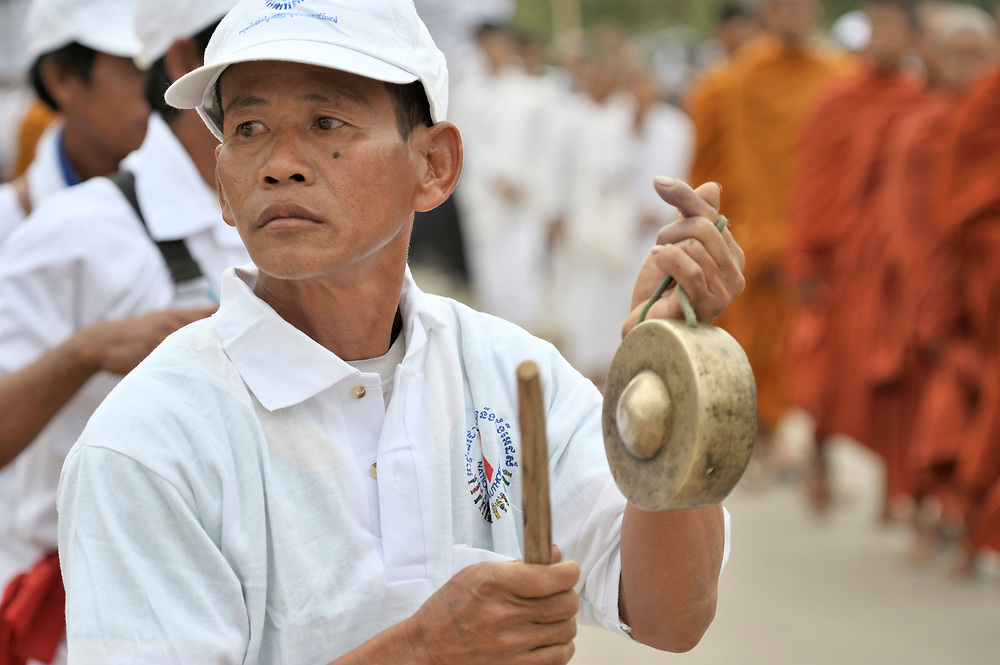 A man plays a cymbal in a march to commemorate World AIDS Day held in Battambang, Cambodia. Among sponsors of the march was the Salvation Centre Cambodia, an organization that works with Buddhist monks and other activists to foster support for people living with HIV and AIDS as well as public education and advocacy throughout the country.