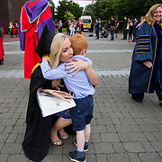 """24.08.2016        <br /> Over 300 students graduated from the Faculty of Science and Engineering at the University of Limerick today. <br /> <br /> Attending the conferring ceremony was Bachelor of Science in Food Science and Health graduate Niamh Burke, Newport Co. Tipperary who was greeted by her son 4 year old Hughie Duggan after the conferring ceremony. Picture: Alan Place.<br /> <br /> As the University of Limerick commences four days of conferring ceremonies which will see 2568 students graduate, including 50 PhD graduates, UL President, Professor Don Barry highlighted the continued demand for UL graduates by employers; """"Traditionally UL's Graduate Employment figures trend well above the national average. Despite the challenging environment, UL's graduate employment rate for 2015 primary degree-holders is now 14% higher than the HEA's most recently-available national average figure which is 58% for 2014"""". The survey of UL's 2015 graduates showed that 92% are either employed or pursuing further study."""" Picture: Alan Place"""