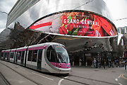 Exterior of Grand Central with a passing Midland Metro light-rail tram in Birmingham, United Kingdom. Grand Central is a shopping centre located in Birmingham, England, that opened on 24 September 2015. It is currently owned by Hammerson and CPPIB. The original centre was built in 1971 as part of the reconstruction of Birmingham New Street station. It was known as the Birmingham Shopping Centre before being renamed as The Pallasades. As part of the New Street Station Gateway Plus redevelopment, Grand Central underwent a major overhaul. The mall has been redesigned with a glass atrium roof as centrepiece, and is home to over 60 stores with John Lewis as main anchor tenant.