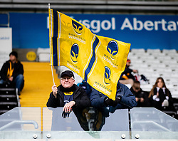 A Worcester Warriors fan waves a flag <br /> <br /> Photographer Simon King/Replay Images<br /> <br /> European Rugby Challenge Cup Round 5 - Ospreys v Worcester Warriors - Saturday 12th January 2019 - Liberty Stadium - Swansea<br /> <br /> World Copyright © Replay Images . All rights reserved. info@replayimages.co.uk - http://replayimages.co.uk