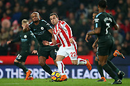 Xherdan Shaqiri of Stoke City © goes past Vincent Kompany of Manchester City (l). Premier league match, Stoke City v Manchester City at the Bet365 Stadium in Stoke on Trent, Staffs on Monday 12th March 2018.<br /> pic by Andrew Orchard, Andrew Orchard sports photography.