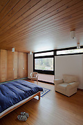 1960s bedroom, wooden clad, bed, chair, slippers, no people