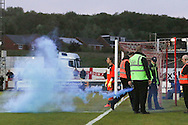 AFC Wimbledon fans throw a flare on the pitch after Bayo Akinfenwa forward for AFC Wimbledon (10) scores during the Sky Bet League 2 play-off 2nd leg match between Accrington Stanley and AFC Wimbledon at the Fraser Eagle Stadium, Accrington, England on 18 May 2016. Photo by Stuart Butcher.