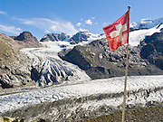 """Pers Glacier flows from Piz Palü (3901 meters or 12,799  feet) into the Morteratsch Glacier (Romansh: Vadret da Morteratsch) in the Bernina massif, in Upper Engadine, Switzerland, the Alps, Europe. A favorite walk is from Morteratsch (second train stop from Pontresina towards Bernina Pass) to Refuge Boval (see its Swiss flag), which has a restaurant and overnight lodging. The trail is well graded, 5 or 6 miles round trip with 2700 feet gain. Return via lower trail for partial loop. The Swiss valley of Engadine translates as the """"garden of the En (or Inn) River"""" (Engadin in German, Engiadina in Romansh, Engadina in Italian)."""