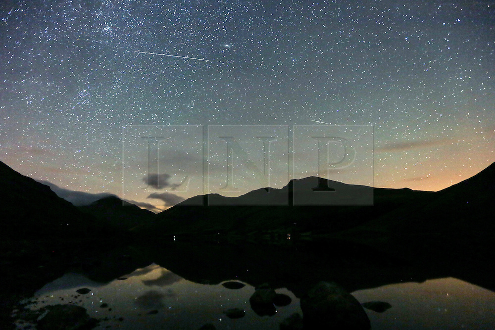 © Licensed to London News Pictures. 12/08/2015. Wasdale Head, UK. Picture shows last nights Meteor shower over Wast water in Wasdale Head, Cumbria.<br /> Photo credit : Andrew McCaren/LNP