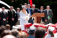 Valedictorian Olivia Fitzpatrick is welcomed to the stage by Prinipal Steve Beals during Laconia High School's 134th Commencement Exercise Saturday morning.  (Karen Bobotas/for the Laconia Daily Sun)